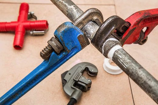 canva plumbing pipe wrench plumber repair maintenance
